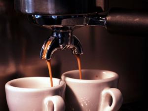 brewing espresso with an espresso maker