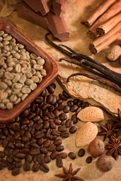 green and roasted coffee beans with chocolate, cinnamon, vanilla, almonds, hazelnuts, nutmeg, and anise seed flavorings