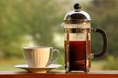 french press and coffee cup